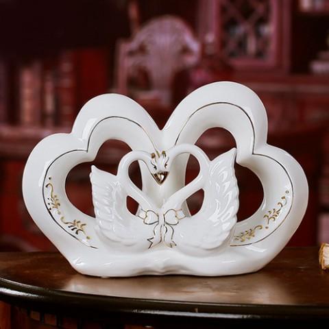 Đôi Thiên Nga gốm sứ trắng trái tim lồng