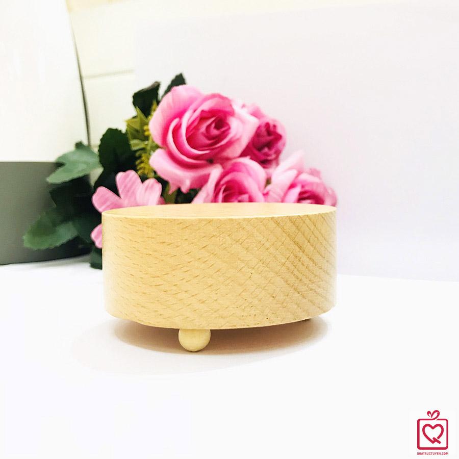 hộp nhạc khắc gỗ đế tròn